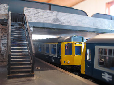 Hornby Class 110 & Bachmann 108 DMU's indulge in a spot of permissive working at Sandley.